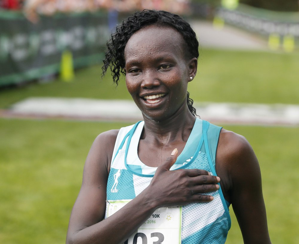 "Demadonna's Mary Keitany of Kenya sets a course record time of 30'45"" to win Peoples Beach to Beacon 10K on Saturday 06"